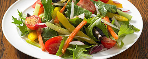 Baby greens with tomatoes red onions and paprika
