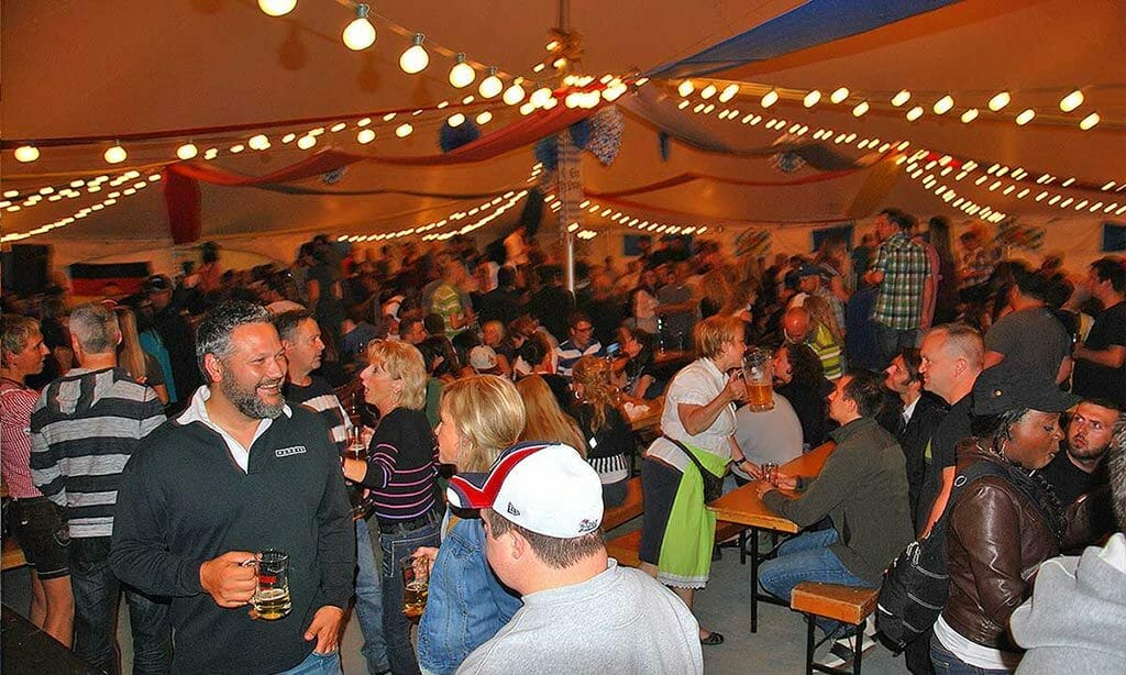 Quebec City Oktoberfest tent full with people the dance and cheer2014