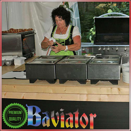 Woman dressed in traditional bavarian costume serves at the Baviator catering bar