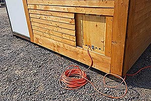 Baviator Kiosk backside with extension cord out of electrical box