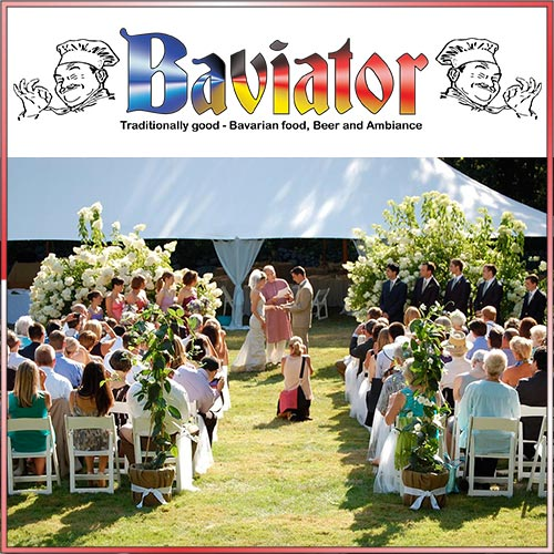 People sitting on chairs in front of a wedding catering tent.