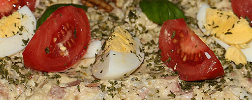 german potato salad with bacon bologna eggs and tomatoes